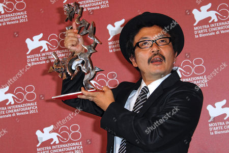 Shion Sono Japanese director Shion Sono shows the Marcello Mastroianni Prize for best emerging actor he picked up on behalf of actors Shota Sometani and Fumi Nikaido for their role in the movie Himizu, during the winners' photo call of the 68th edition of the Venice Film Festival in Venice, Italy