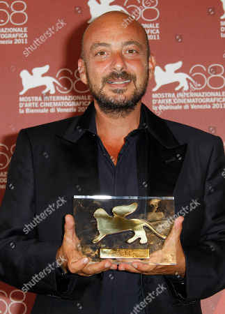 Emanuele Crialese Director Emanuele Crialese holds the Jury's Special Prize for the movie Terraferma during the winners' photo call of the 68th edition of the Venice Film Festival in Venice, Italy