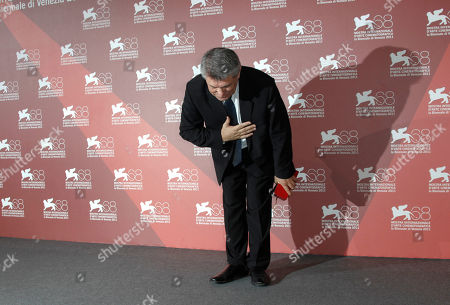Aleksandr Sokurov Director Aleksandr Sokurov takes a bow whilst holding the Golden Lion for best film for Faust, during the winners' photo call of the 68th edition of the Venice Film Festival in Venice, Italy