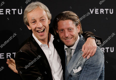 President of Vertu, Perry Oosting hugs with Italian stylist Lapo Elkann as they attend a presentation of a new smartphone in Milan, Tuesday, Oct.18, 2011