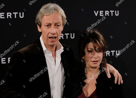 President of Vertu, Perry Oosting poses with his wife at a presentation of a new smartphone in Milan, Tuesday, Oct.18, 2011