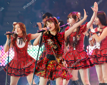 Yuko Oshima, Tomomi Itano, Rino Sashihara Members of Japan's most popular girl group AKB48, Yuko Oshima, second from left, Tomomi Itano, left, Rino Sashihara, third from right, and others perform during a special event in Tokyo