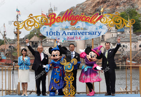 From left to right: Tokyo Disney Resort Ambassador Tomoko Baba, Oriental Land Co., Ltd. Chairman Toshio Kagami, Mickey Mouse, Oriental Land Co., Ltd. President Kyoichiro Uenishi, Minnie Mouse and Walt Disney Parks and Resorts World Wide Chairman Tom Staggs wave to the guests as Tokyo Disney SEA marked the 10th anniversary at the theme park in Urayasu, near Tokyo