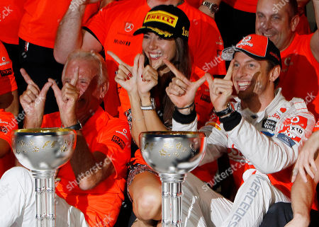 Jenson Button, Jessica Michibata, John Button McLaren driver Jenson Button of Britain, right, celebrates with girlfriend Jessica Michibata, center, his father John, left, and team members after Button won the Japanese Formula One Grand Prix at the Suzuka Circuit in Suzuka, central Japan