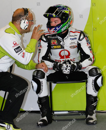 Stock Picture of Damian Cudlin Australia's Damian Cudlin talks with a team member during a practice session ahead of Sunday's MotoGP Japanese Grand Prix at the Twin Ring Motegi circuit in Motegi, north of Tokyo