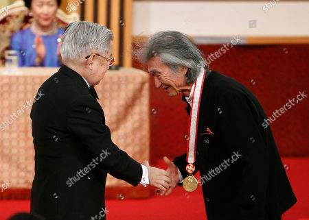 Seiji Ozawa, Hitachi, Hanako Japanese conductor Seiji Ozawa, right, shakes hands with Prince Hitachi during an awarding ceremony of the Praemium Imperiale in Tokyo, . Applauding in the background is Hitachi's wife Princess Hanako