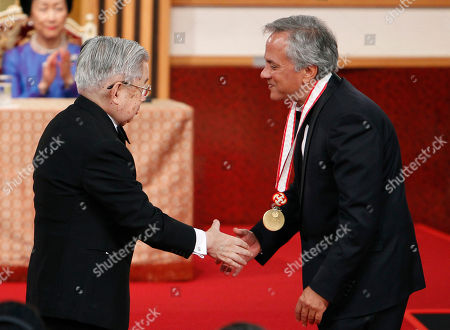 Anish Kapoor, Hitachi, Hanako Sculptor Anish Kapoor of Britain, right, shakes hands with Prince Hitachi during an awarding ceremony of the Praemium Imperiale in Tokyo, . Applauding in the background is Hitachi's wife Princess Hanako
