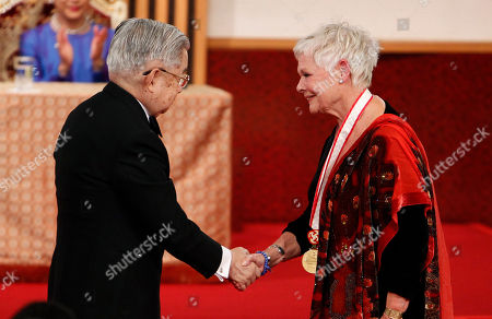 Judi Dench, Hitachi, Hanako British actress Judi Dench, right, shakes hands with Prince Hitachi during an awarding ceremony of the Praemium Imperiale in Tokyo, . Applauding in the background is Hitachi's wife Princess Hanako