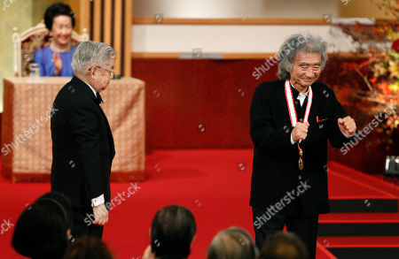 Seiji Ozawa, Hitachi, Hanako Japanese conductor Seiji Ozawa, right, reacts after receiving a medal from Prince Hitachi during an awarding ceremony of the Praemium Imperiale in Tokyo, . Applauding in the background is Hitachi's wife Princess Hanako