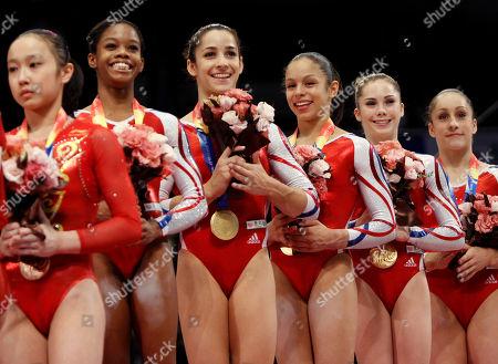 USA'S gymnasts from second left, Gabrielle Douglas, Alexandra Raisman, Sabrina Vega, McKayla Maroney and Jordyn Wieber, celebrate on the podium after winning the women's team final at the Artistic Gymnastics World Championships in Tokyo, Japan