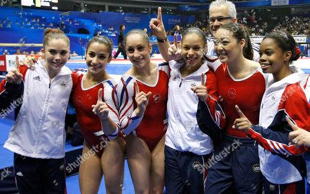 USA's gymnasts, from left, McKayla Maroney, Alexandra Raisman, Jordyn Wieber, Sabrina Vega, and Gabrielle Douglas, far right, celebrate after winning the women's team final at the Artistic Gymnastics World Championships in Tokyo, Japan