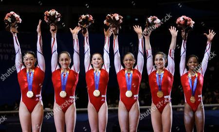 USA's gymnasts, from left, Anna Li, Jordyn Wieber, McKayla Maroney, Sabrina Vega, Alexandra Raisman and Gabrielle Douglas celebrate after winning the women's team final at the Artistic Gymnastics World Championships in Tokyo, Japan