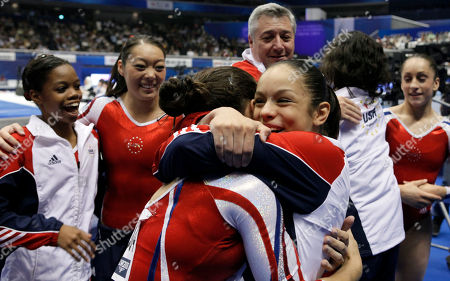USA's Sabrina Vega, center, celebrates with teammates after winning the women's team final at the Artistic Gymnastics World Championships in Tokyo, Japan