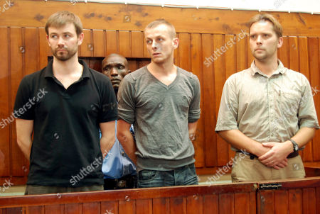 British nationals Nicholas John Cryne,left, Benjamin John Hope, second right, and Gregory Todd Young,right, in the dock when they appeared before the Mombasa Senior Principal Magistrate Lilian Mtende, charged with unlawful employment. The three who were arrested on September 21, 2011 at Tudor village within Mombasa town appeared before the senior Principal Magistrate and were charged with operating business namely 'private investigations, yet they were not Kenyan citizens and were doing the work without any authorization by an entry permit or were not exeept by regulations made under the Immigration Act. The third charge stated that the three misled Immigration officers who were on duty that they were visiting Kenya for a period of five days for holiday while the visit was to conduct business namely private investigations in contravention of the immigration Act of Kenya. The three pleaded guilty and were each fined 35,000 Kenyan Shillings 220.35 pounds