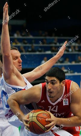 Turkey's Enes Kanter, right, challenges for the ball with Serbia's Dusko Savanovic, during their EuroBasket European Basketball Championship Group E match in Vilnius, Lithuania