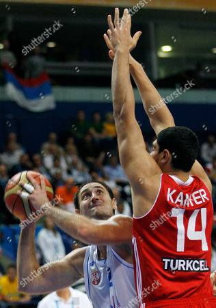 Serbia's Nenad Krstic, left, challenges for the ball with Turkey's Enes Kanter during their EuroBasket European Basketball Championship Group E match in Vilnius, Lithuania