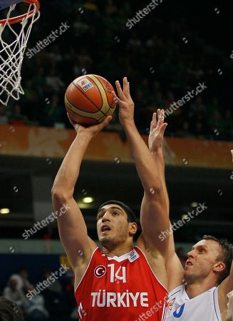 Turkey's Enes Kanter, left, challenges for the ball with Serbia's Dusko Savanovic, during their EuroBasket European Basketball Championship Group E match in Vilnius, Lithuania