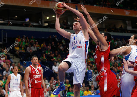 Dusko Savanovic, Enes Kanter Dusko Savanovic, center, of Serbia is challenged by Enes Kanter, right, from Turkey during the EuroBasket 2011, European Basketball Championships group E match between Serbia and Turkey in Vilnius, Lithuania, on