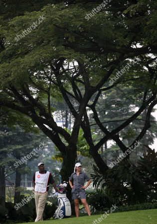 Paige Mackenzie Paige Mackenzie, right, of the United States and her caddy take a break under trees during the second round of the LPGA Malaysia golf tournament at Kuala Lumpur Golf and Country Club in Kuala Lumpur, Malaysia