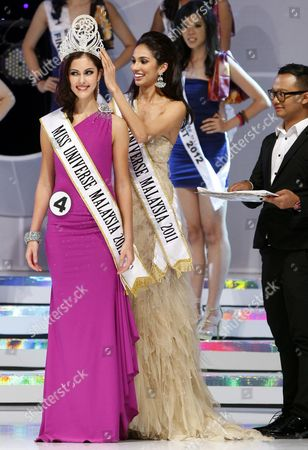 Stock Image of Kimberly Leggett, Deborah Henry Kimberly Leggett, left, 18, is crowned the Miss Universe Malaysia 2012 by Miss Universe Malaysia 2011 Deborah Henry, center, in Petaling Jaya, near Kuala Lumpur, Malaysia