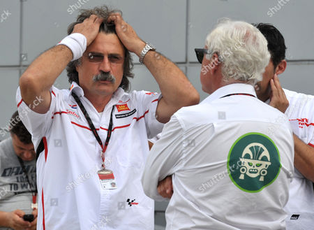 Paolo Simoncelli Paolo Simoncelli, father of Italy's Marco Simoncelli, left, reacts outside the medical center after the accident involving Simoncelli, Valentino Rossi of Italy and Colin Edwards of the US, at the Malaysian MotoGP Grand Prix in Sepang, Malaysia, . A Malaysian MotoGP official says Italian rider Simoncelli has died after an accident at the race. Norlina Ayob, press officer with the Sepang circuit, says Simoncelli, 24, died as a result of his injuries