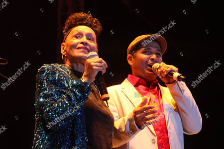 Stock Picture of Omara Portuondo Cuba's singer Omara Portuondo, left, performs with Carlos Calunga of Buena Vista Social Club at the Plaza de Toros Mexico in Mexico City, late