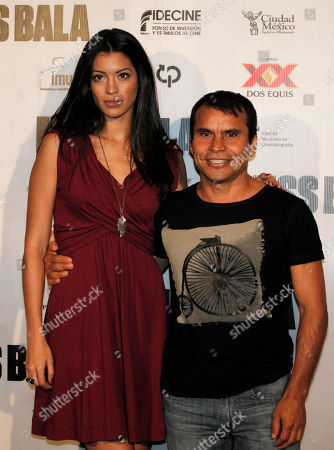 """Noe Hernandez, Stephanie Sigman Mexican actors Noe Hernandez, right, and Stephanie Sigman pose for pictures during a press conference to promote the film """"Miss Bala"""" in Mexico City, . Miss Bala will be released next Sep. 9 in Mexico"""