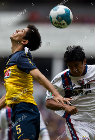 America's Jesus Molina, left, and Atlante's Luis Venegas head a ball during a Mexican soccer league match in Mexico City