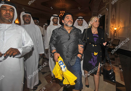 Al Wasl coach Diego Maradona, 3rd right, with his partner Veronica Ojeda leave after a press conference in Dubai, United Arab Emirates