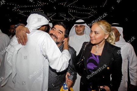 Al Wasl coach Diego Maradona, 2nd left, and his partner Veronica Ojeda leave after a press conference in Dubai, United Arab Emirates