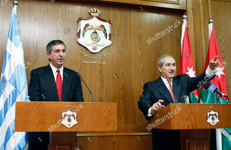Stavros Lambrinidis, Nasser Judeh Greek Foreign Minister Stavros Lambrinidi, left, and his Jordanian counterpart Nasser Judeh appear at a joint press conference in Amman, Jordan, . Jordan's foreign minister says Israeli settlement activities have hindered the resumption of direct Israeli-Palestinian negotiations