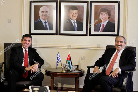Stavros Lambrinidis, Nasser Judeh Greek Foreign Minister Stavros Lambrinidi, left, and his Jordanian counterpart Nasser Judeh smile during their meeting in Amman, Jordan, . Jordan's foreign minister says Israeli settlement activities have hindered the resumption of direct Israeli-Palestinian negotiations