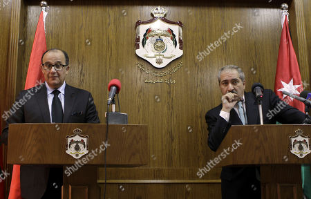 Stock Photo of Nasser Judeh, Taib Fassi Fihri Jordanian Foreign Minister Nasser Judeh, right speaks during a press conference with his Moroccan counterpart Taib Fassi Fihri, left after their meeting in Amman, Jordan