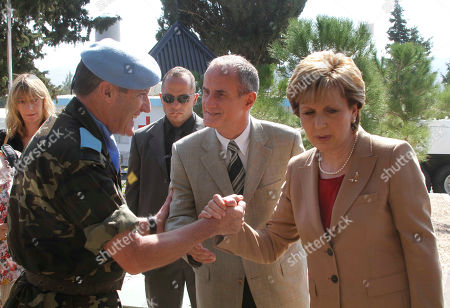 Mary McAleese, Alberto Asarta Cuevas Irish President Mary McAleese, right, and her husband Dr Martin McAleese, center, shake hands with UNIFIL commander Maj. Gen. Alberto Asarta Cuevas, left, at the Irish UN peacekeepers base in the southern village of Tebnine, Lebanon, on . McAlees arrived in Lebanon on Friday on a three days visit to meet with Lebanese officials and to check the Irish soldiers serving with UN peacekeeping unit in south Lebanon