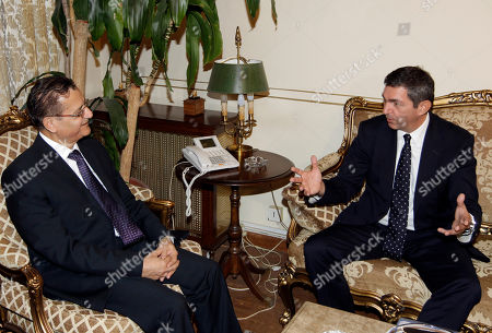 Lebanese Foreign Minister Adnan Mansour, left, meets with his Greek counterpart Stavros Lambrinidis, right, in Beirut, Lebanon, . Lambrinidis, who is heading a delegation that includes businessmen, is expected to urge Lebanon to invest in Greece