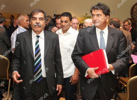 Ali al-Tarhouni, Pierre Lellouche Libyan minister of finance and oil Ali al-Tarhouni, left and French minister of commerce Pierre Lellouche leave after attending a commercial conference in Tripoli, Libya