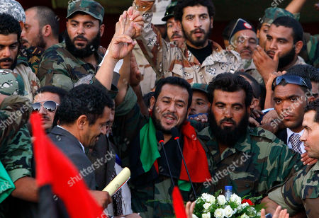 Abdel Hakim Belhaj Libyan National Transitional Council military commander of Tripoli Abdel Hakim Belhaj waves prior to his speech at Saha Kish Square in Benghazi, Libya, as Libya's transitional government declare liberation of Libya after months of bloodshed that culminated in the death of longtime leader Moammar Gadhafi. Libya's elections bring in a large new political generation of independents _ businessmen, activists, former judges and former exiles _ who form the largest bloc in the first elected national assembly after Moammar Ghadafi's fall and will be the big wild card in determining the country's course. Both a coalition led by secular former Prime Minister Mahmoud Jibril and Islamists led by the Muslim Brotherhood are trying to woo them, but many of the independents are trying to form their own coalition, distrusting both sides