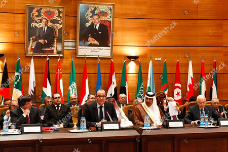 Stock Image of Ahmet Davutoglu, Taib Fassi Fihri, Hamad bin Jassim, Nabil Al Arabi Arab League members, with from left to right at front, Turkey's Foreign Minister Ahmet Davutoglu, Morocco's Foreign Minister Taib Fassi Fihri, Qatari Foreign Minister Hamad bin Jassim and Egyptian's Nabil Al Arabi President of Arab League, as they attend the Arab League foreign ministers meeting in Rabat, Morocco, . Foreign ministers from the 22-member Arab League nations on Wednesday are expected to formalize their weekend decision to suspend Syria for refusing to end its bloody crackdown against anti-government protesters