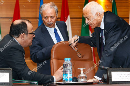 Taib Fassi Fihri, Nabil Al Arabi, Benhalli Ahmed Egyptian's Nabil Al Arabi, President of Arab League, right, chats with Morocco's Foreign Minister Taib Fassi Fihri, left, as Benhalli Ahmed Vice President of Arab League, center, looks on at the Arab League foreign ministers in Rabat, Morocco Wednesday, Nov 16. 2011. Foreign ministers from the 22-member Arab League on Wednesday are expected to formalize their weekend decision to suspend Syria for refusing to end its bloody crackdown against anti-government protesters
