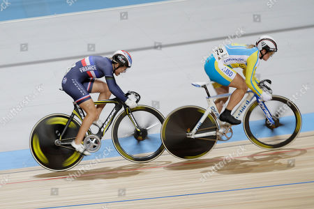 Clara Sanchez of France, left, and Lyubov Shulika of the Ukraine, right, compete during the semi finals of the women 200 meters time trial at the European Championships Track Cycling in Apeldoorn, eastern Netherlands