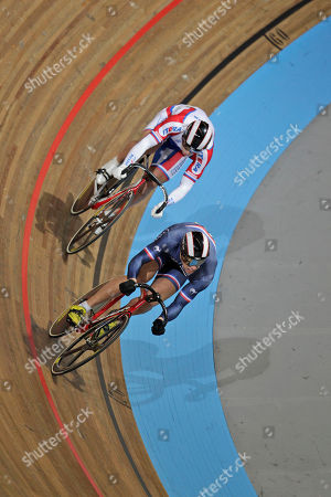 Kevin Sireau of France, foreground, and Denis Dmitriev of Russia compete during the semi finals of the men 200 meters time trial at the European Championships Track Cycling in Apeldoorn, eastern Netherlands