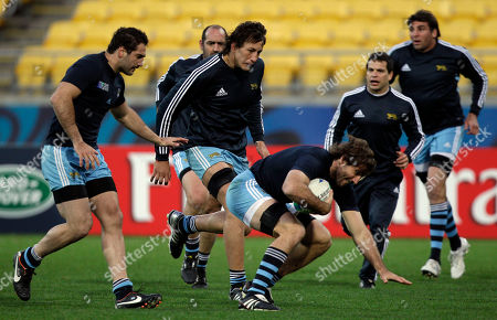 Felipe Contepomi, Santiago Phelan Argentine rugby player Juan Martin Fernandez Lobbe, center, runs with the ball followed from left by Juan Manuel Leguizamon, Patricio Albacete, Nicolas Vergallo and Julio Farias Cabello during the captain's run at the Wellington Regional stadium, New Zealand, . Argentina will play their next Rugby World Cup game against Scotland on Sep. 25, 2011