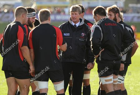 Canadian forwards coach Neil Barnes, centre, talks to his players prior to their Rugby World Cup Pool A game against Tonga at the Northland Events Centre in Whangarei, New Zealand