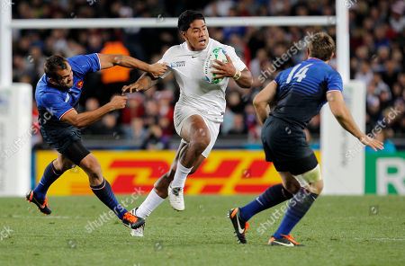 England's Manu Tuilagi runs past France's Fabrice Estebanez during their Rugby World Cup quarterfinal in Auckland, New Zealand