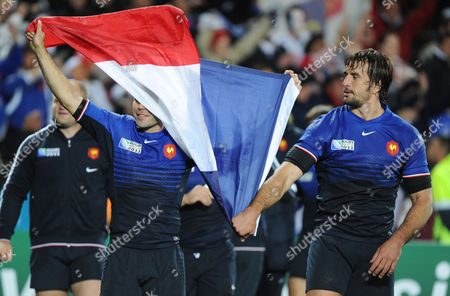 France's Dimitri Yachvili and teammate Julien Pierre hold a flag after their Rugby World Cup quarterfinal win against England in Auckland, New Zealand, Saturday, Oct 8. 2011