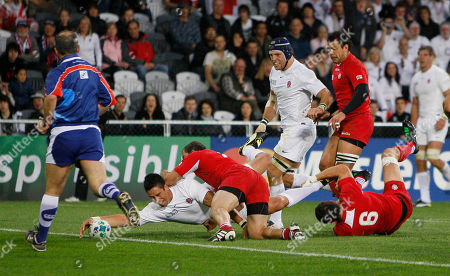 England's Shontayne Hape reaches out to score a try against Georgia during their Rugby World Cup game at the Otago Stadium in Dunedin, New Zealand, Sunday, Sept., 18, 2011