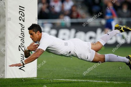 England's Shontayne Hape dives over for a try against Georgia during their Rugby World Cup game at the Otago Stadium in Dunedin, New Zealand, Sunday, Sept., 18, 2011