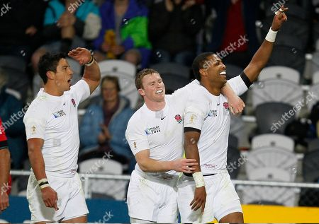 England's Delon Armitage, right, is congratulated on his try by teammates Chris Ashton and Shontayne Hape, left, during their Rugby World Cup game against Georgia at the Otago Stadium in Dunedin, New Zealand, Sunday, Sept., 18, 2011