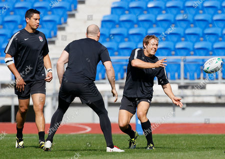Stock Photo of England rugby players from the left Shontayne Hape, Mike Tindall and Jonny Wilkinson play touch rugby during a training session in Auckland, New Zealand, . England play Scotland in their next World Cup Rugby match at Eden Park, Auckland on Saturday, Oct. 1