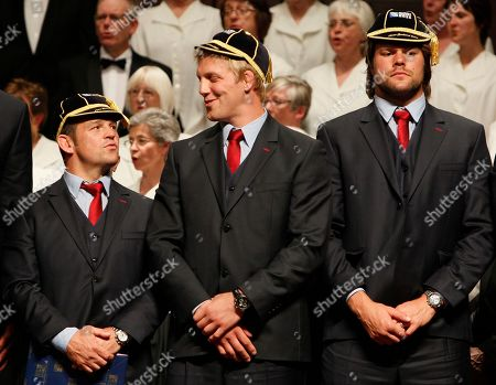 England rugby players from left, Lee Mears, Lewis Moody and Tom Palmer, react after they received their caps for the Rugby World Cup during the official welcome ceremony at theTown Hall in Dunedin, New Zealand, Tuesday, Sept., 6, 2011.England play Argentina in their opening Rugby World Cup game on Sep. 10